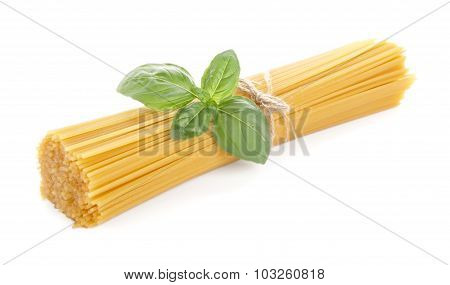 Long Pasta Raw Isolated With Basil Leaf On White Background