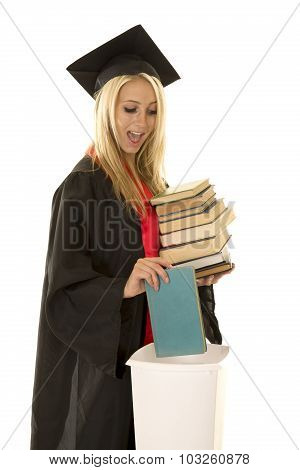 Woman In Black Graduation Gown Throw Away Book