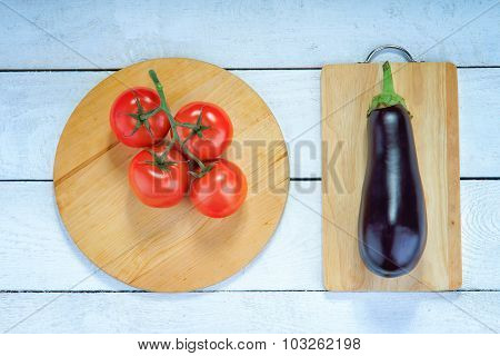 Marrow, tomatoes and wooden cutting boards