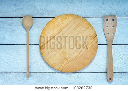 Wooden cutting board, spatula and spoon