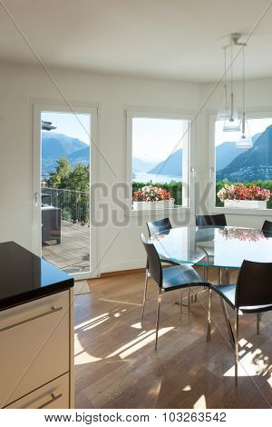 interior of a furnished house, dining room with glass table