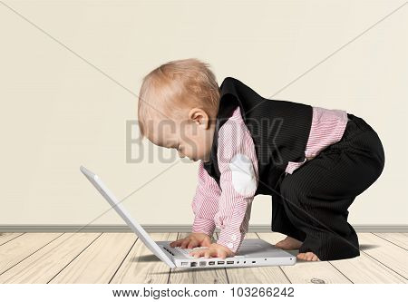 Baby With Computer.