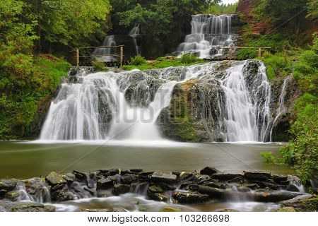 Nice waterfall in autumn forest, take it in Ukraine