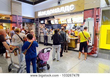 SAINT PETERSBURG, RUSSIA - JULY 08, 2015: McDonald's restaurant interior. The McDonald's Corporation is the world's largest chain of hamburger fast food restaurants.