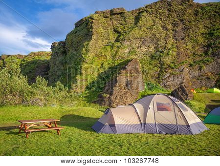 Dome tent at campsite in Iceland in a morning light