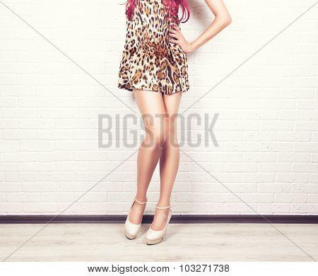 woman legs in elegant silver high heel shoes