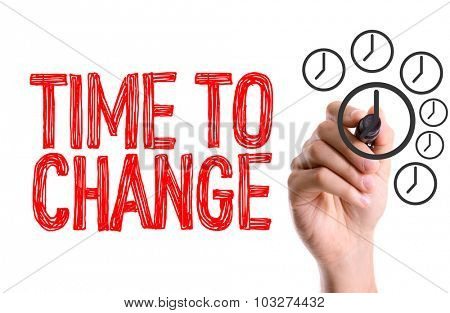 Hand with marker writing: Time To Change