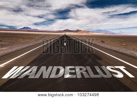 Wanderlust written on desert road