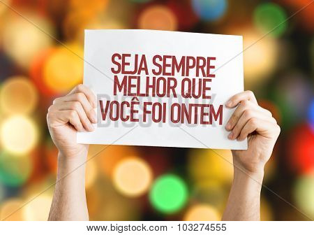 Be Better Than You Were Yesterday (in Portuguese) placard with bokeh background