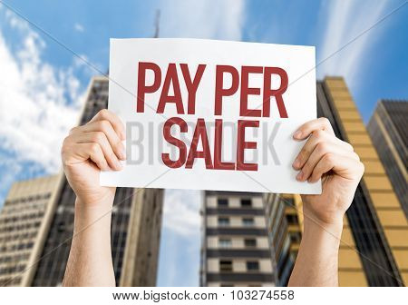 Pay Per Sale placard with cityscape background