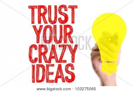 Hand with marker writing: Trust Your Crazy Ideas