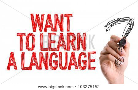 Hand with marker writing: Want to Learn a Language?