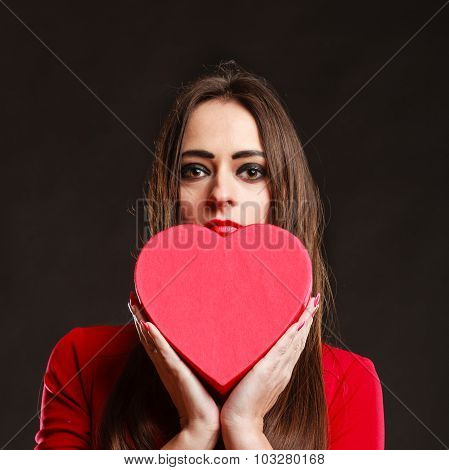 Girl In Red Holding Heart Box.