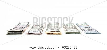 Piles of various dollar notes. All on white background
