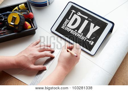 Man Plans Design Project Using Application On Digital Tablet