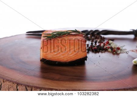 breakfast delicious portion of fresh roast salmon fillet with spices garlic rosemary wooden plate black forged handmade fork healthy food diet cooking concept isolated on white background empty space