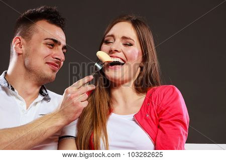 Smiling Man Feeding Happy Woman With Banana.