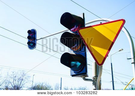 Traffic Lights And Yield Sign On Sky Background.
