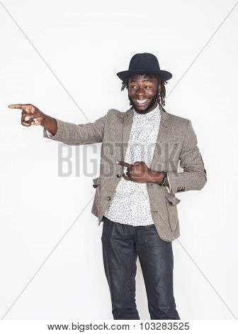 young handsome afro american boy in stylish hipster hat gesturing emotional isolated