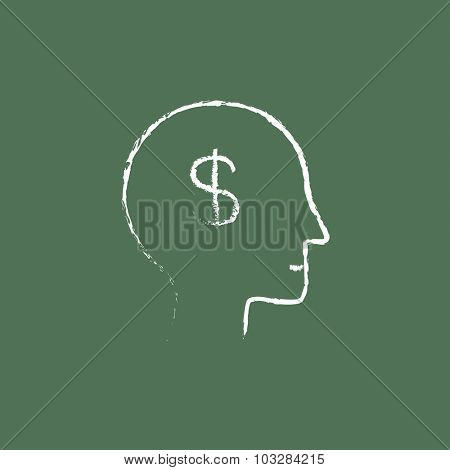 Head with dollar symbol hand drawn in chalk on a blackboard vector white icon isolated on a green background.