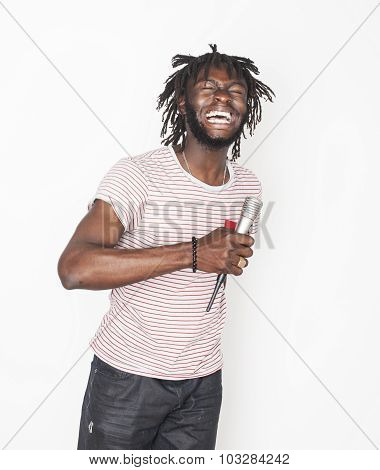 young handsome african american boy singing emotional with microphone isolated on white background