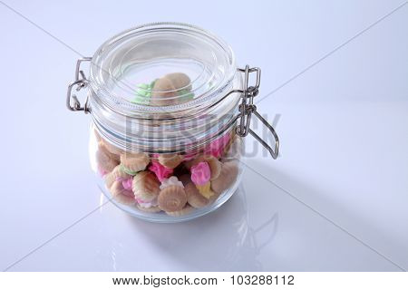 Belly button iced gem biscuits in a glass jar