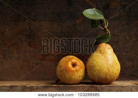Organic pears on wooden shelf