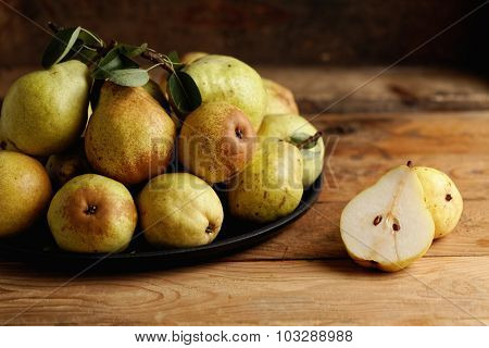 Organic pears on wooden table