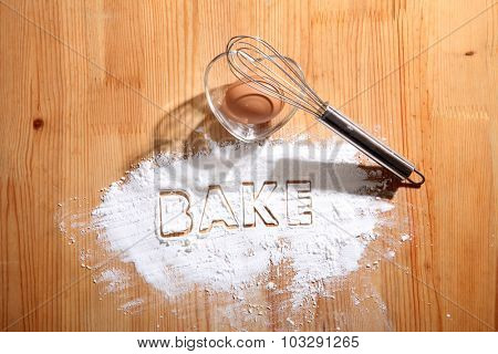 baking concept,hand whisk and eggs