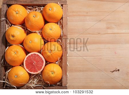 grapefruit in the wooden crate with straw