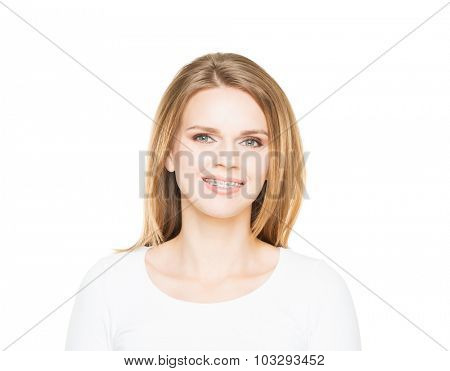 Attractive teenage girl smiling in teeth retainer. Stomatology concept.