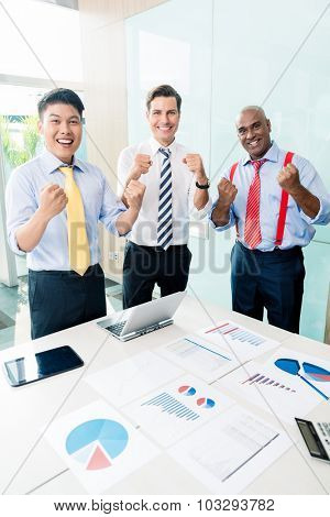 Indian CEO reporting success in business meeting