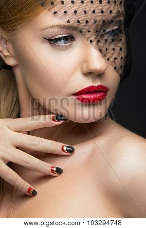 Beautiful girl with a veil, evening makeup, black and red nails. Design manicure. Beauty face.