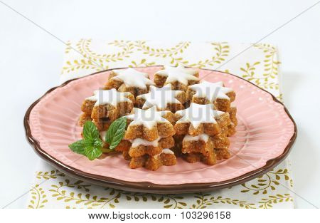 gingerbread stars with glaze, served on the pink plate