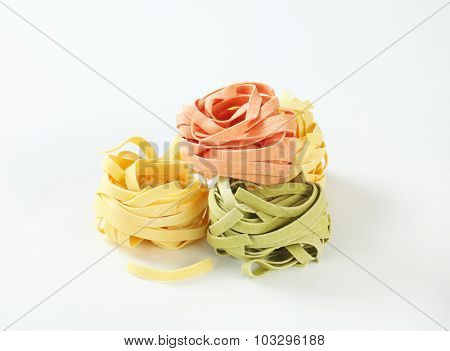 pieces of dry tricolored pasta