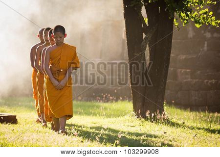 Nakhonratchasima, Thailand - September 19, 2015 : Buddhist Monk Walking The Temple On The Sunlight