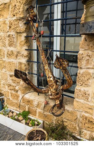 The Old Metal Anchor Attached To The Bars On The Window Of The Building