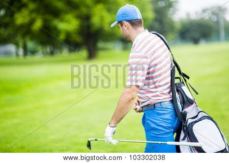 Golfer Carrying His Equipment