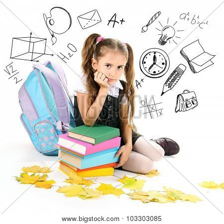 Little schoolgirl  with school  icons, isolated on white