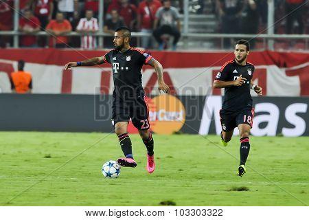 Arturo Vidal (l) And Juan Bernat (r) During The Uefa Champions League Game Between Olympiacos And Ba