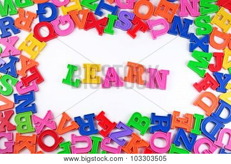 Learn Written By Plastic Colorful Letters On A White
