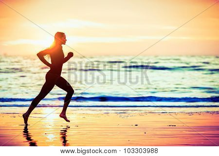 Woman running on the beach at sunset - male version in portfolio