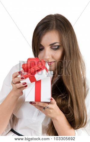 Beautiful Girl Opening White Box With A Red Bow. In The Box Is A Gift