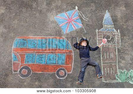 Little Kid Boy In British Policeman Uniform With London Picture
