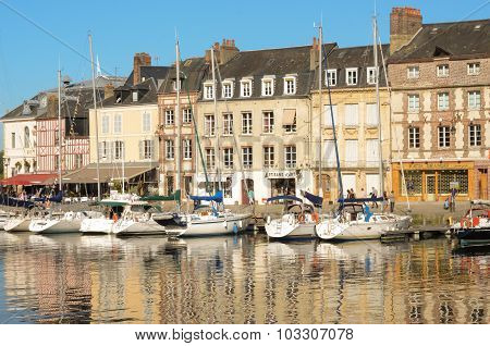 Beautiful yachts at the Honfleur harbor and old city