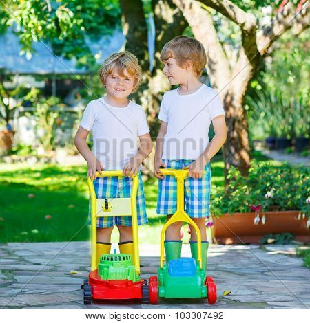 Two Little Boys Playing With Lawn Mower Toys