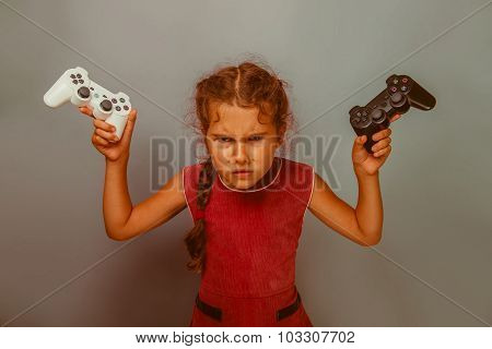 Girl European appearance decade holds two gaming joystick in his