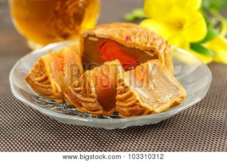 Delicious Mooncakes Sliced Into Pieces On A Glass Plate.