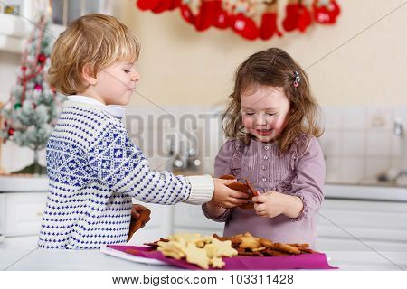 Boy And Girl Baking Christmas Cookies At Home