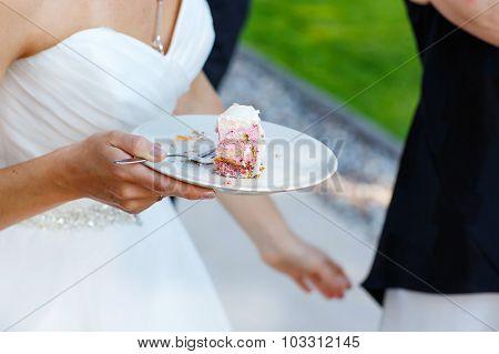 Bride Holding Delicious Wedding Cake